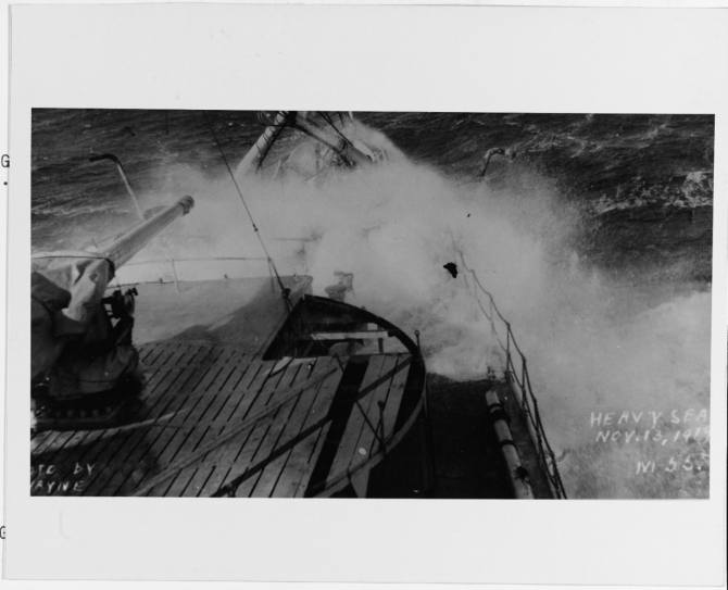 The ship plunges through heavy seas while crossing the Atlantic during her return to the United States, 13 November 1919. (R.E. Wayne, U.S. Navy Photograph NH 2470, Photographic Section, Naval History and Heritage Command)