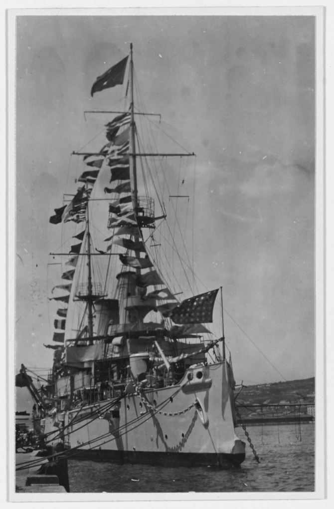 Olympia gaily dresses with flags and celebrates Bastille Day while at Fiume on the Adriatic Sea, 14 July 1919. (R.E. Wayne J-61, U.S. Navy Photograph NH 43260, Photographic Section, Naval History and Heritage Command)