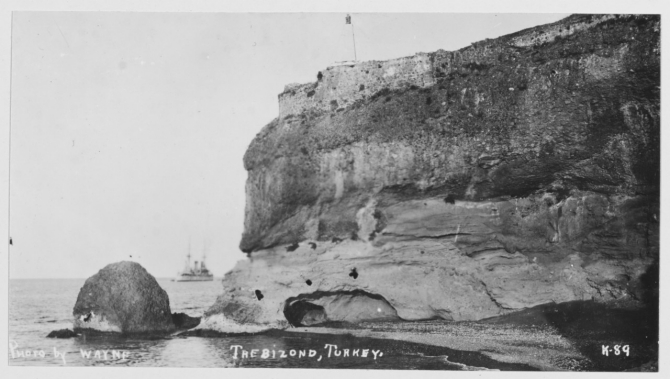Olympia rounds the headland at Trebizond [Trabzon], Turkey, the ancient Byzantine and Turkish fortress visible atop the cliff, August 1919. (R.E. Wayne K-89, U.S. Navy Photograph NH 122302, Photographic Section, Naval History and Heritage Command)