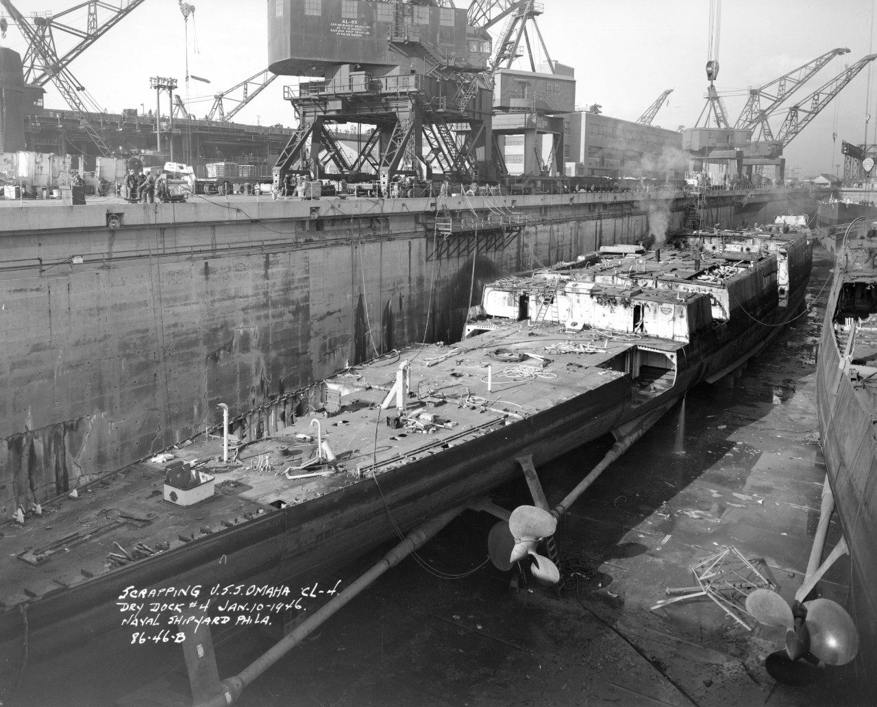 Scrapping ex-Omaha proceeds at the Philadelphia Naval Shipyard, 10 January 1946, a process being carried out on two of her sisters (R) in the same dry dock. (Ships History Files, Naval History and Heritage Command, History and Archives Division)