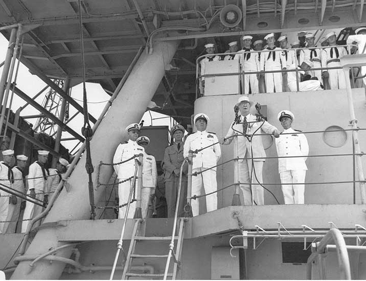 Secretary of the Navy Frank Knox, accompanied by Vice Adm. Jonas H. Ingram, addresses Omaha's crew, 4 October 1943, at Recife. (U.S. Navy Photograph 80-G-54197, National Archives and Records Administration, Still Pictures Branch, College Park, Md.)