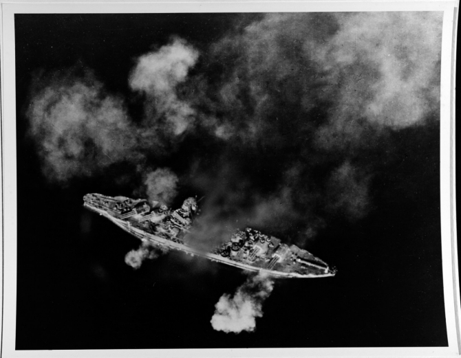 Pennsylvania firing her 14-inch/45 and 5-inch/38 guns while bombarding Guam, south of the Orote Peninsula, on the first day of landings, 21 July 1944. (Naval History and Heritage Command Photograph NH 67584)