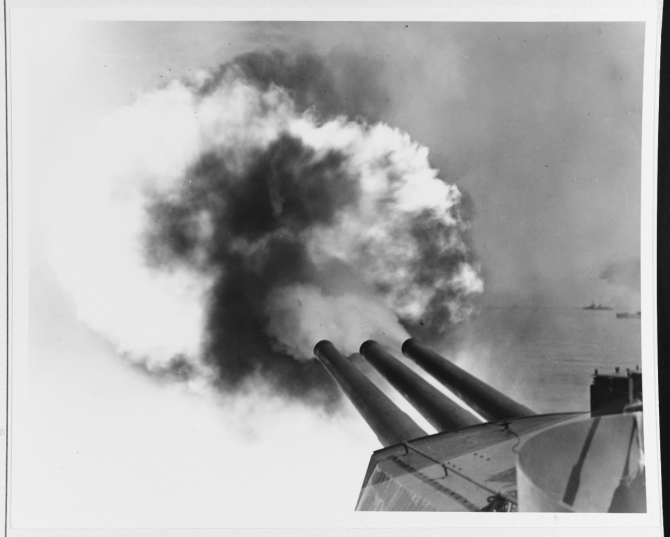 Pennsylvania's 14-inch guns firing on Leyte on 20 October 1944. (U.S. Navy Photograph 80-G-288473, National Archives and Records Administration, Still Pictures Division, College Park, Md.)