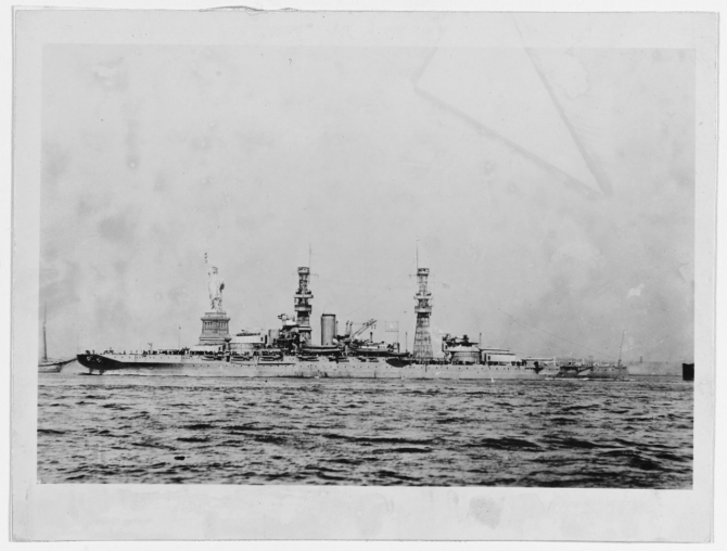 Pennsylvania in New York Harbor with the Statue of Liberty beyond her, during the early 1920s. Note planes atop her turrets, and short-range battle practice target rigged amidships. (Naval History and Heritage Command Photograph NH 42742)