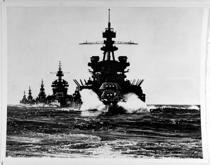 Pennsylvania followed by Colorado (BB-45) and the cruisers Louisville (CA-28), Portland (CA-33), and Columbia (CL-56) move in line into Lingayen Gulf preceding the landing on Luzon, 7-8 January 1945. (Naval History and Heritage Command Photograph NH 67432)