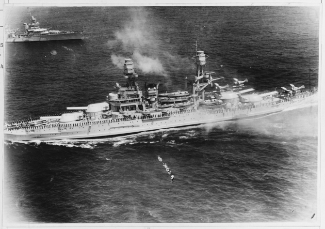 Pennsylvania, foreground, and Indianapolis (CA-35) as seen from the air, salute President Franklin D. Roosevelt during the fleet review of 31 May 1934. (Naval History and Heritage Command Photograph NH 686)