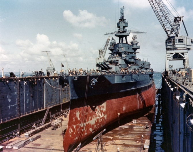 Pennsylvania drydocked in ABSD-7, October 1944. Note the extensive anti-torpedo blister built into her hull side and paravane streaming chains running from her forefoot to her foredeck. (U.S. Navy Photograph 80-G-K-2106, National Archives and Records Administration, Still Pictures Division, College Park, Md.)