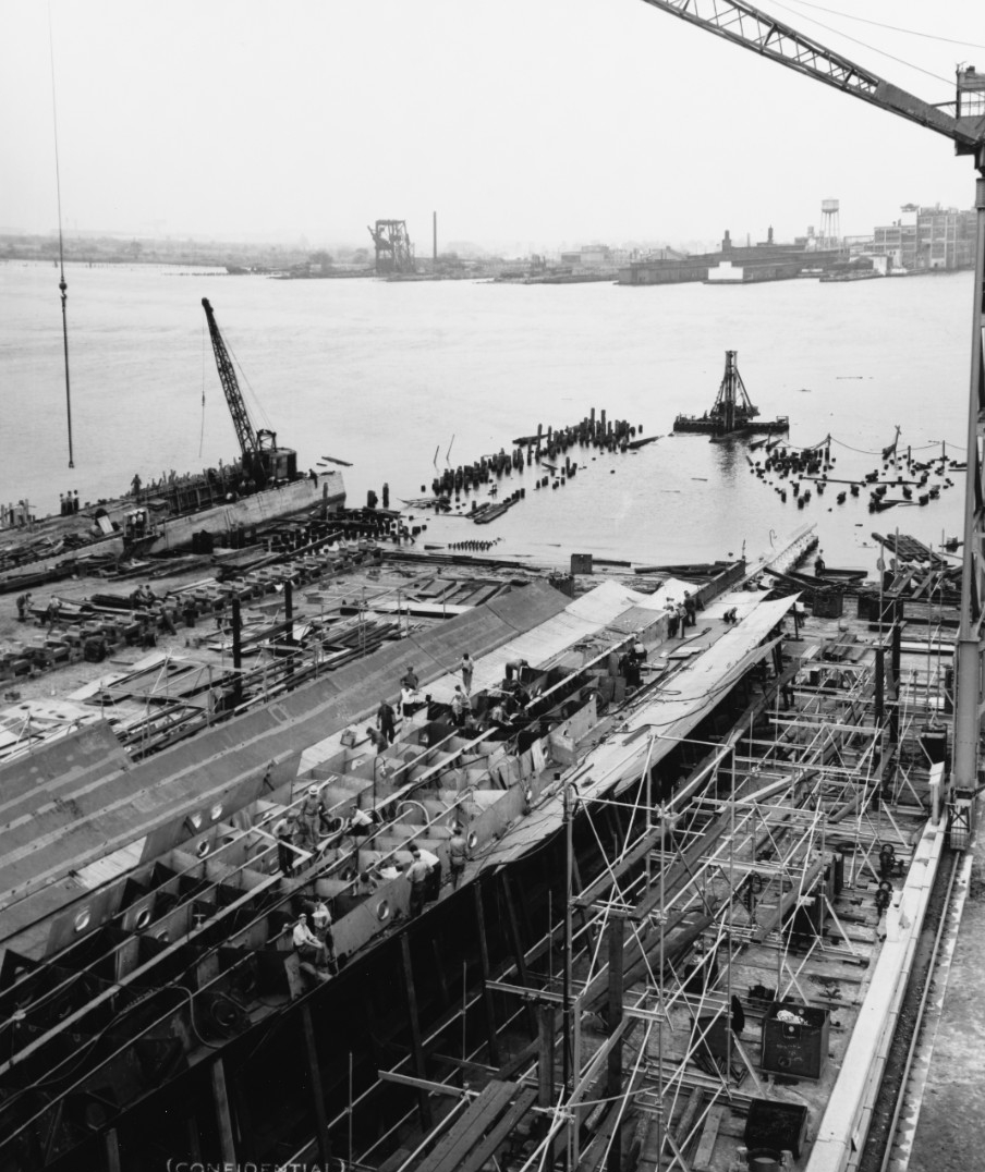 Tallahassee under construction at New York Shipbuilding Corp., Camden, N.J., 1 July 1941. This view looking aft from about amidships shows the keel, double bottom structure, and bottom planking. (U.S. Navy Bureau of Ships Photograph 19-N-44097, National Archives and Records Administration, Still Pictures Division, College Park, Md.)