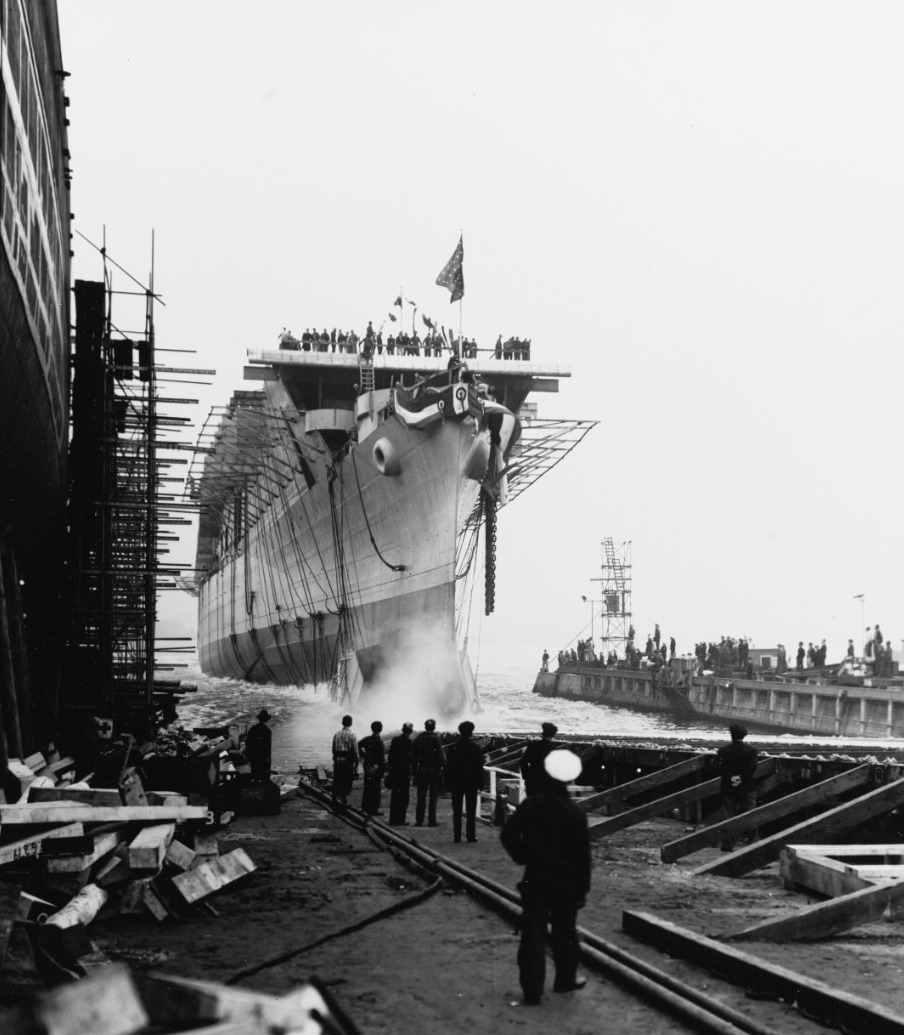 Princeton slides down the way as she is launched at her building yard, 18 October 1942. (U.S. Navy Bureau of Ships Photograph 19-N-46451, National Archives and Records Administration, Bureau of Ships Collection, College Park, Md.)