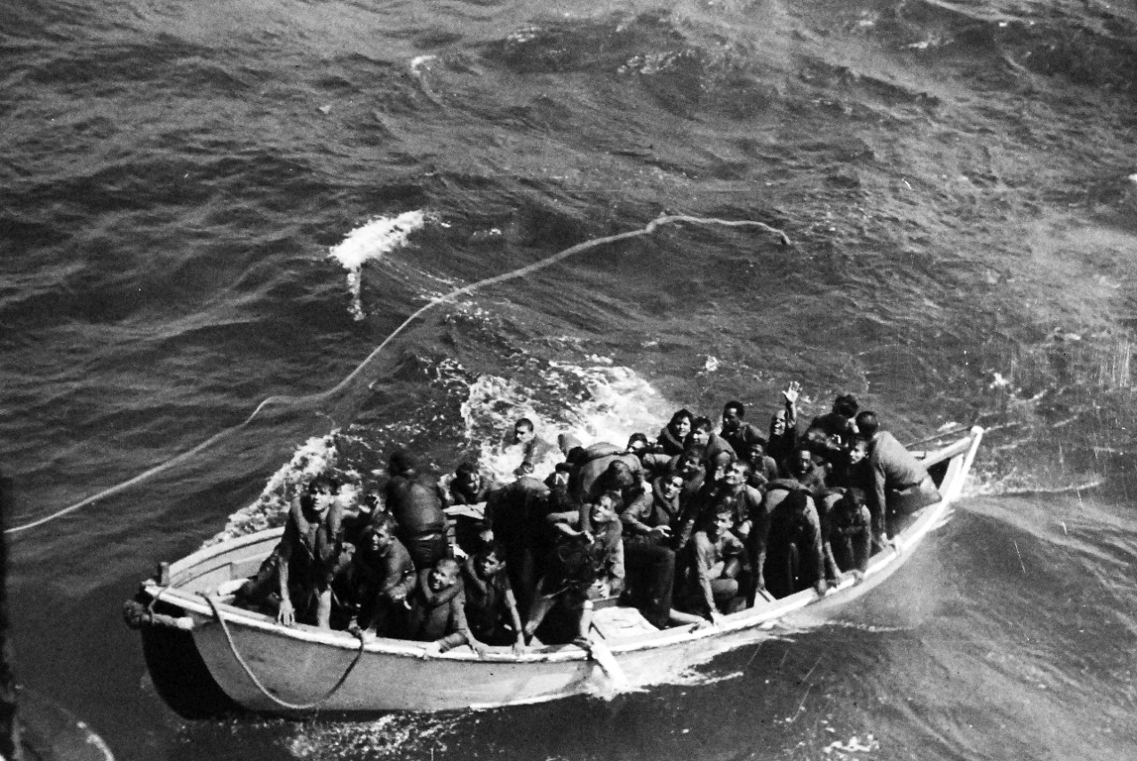 Survivors jump from a motor whaleboat to Cassin Young, 24 October 1944. (U.S. Navy Photograph 80-G-281662-6, National Archives and Records Administration, Still Pictures Division, College Park, Md.)