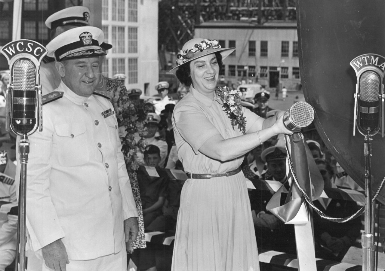 Mrs. Cordelia P. Kane prepares to christen Pringle (DD-477) at the Charleston (S.C.) Navy Yard, as Rear Adm. William H. Allen stands by to assist, 2 May 1942. (USS Pringle, Ship Naming File Box 172, Naval History and Heritage Command)