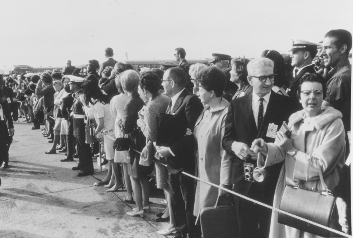 Families, friends, and Navy representatives eagerly await the Starlifters' arrival at Miramar, 24 December 1968. (PHC V. O. McColley, Naval History and Heritage Command Photograph K-67365)