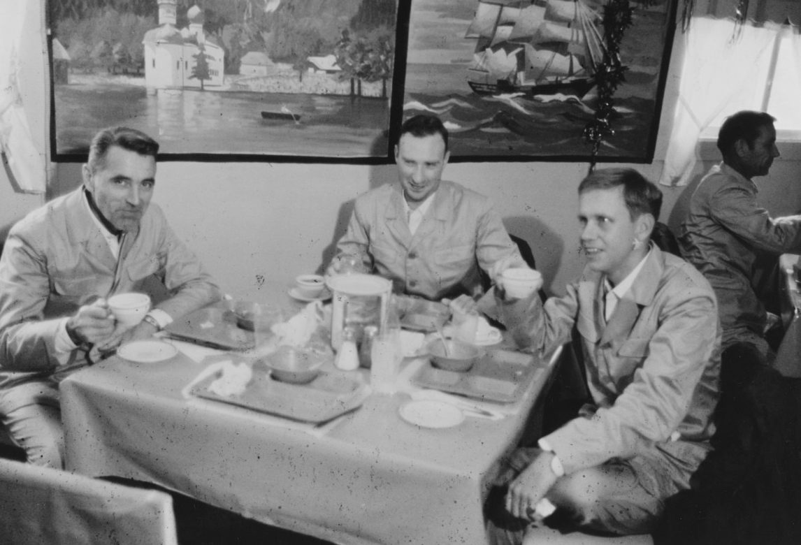 Some of the survivors, relieved to be free, eat a hearty meal at the United Nations Advanced Camp in the Korean DMZ, 23 December 1968. The men wear the new uniforms that the North Koreans provide them in order to help deceive the public into believing that the jailers have treated the prisoners well. (Naval History and Heritage Command Photograph K-64725)
