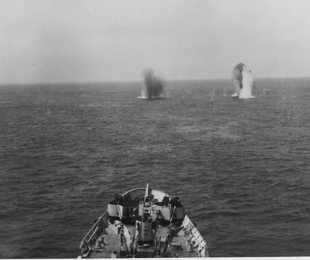 German shells splash off Quincy's bow, as seen from her bridge, 25 June 1944. (Naval History and Heritage Command Photograph NH 82515)