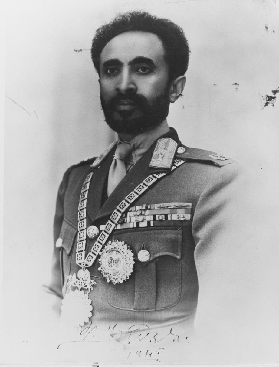 Emperor Haile Selassie signs and presents this picture to Quincy during his visit, 13 February 1945. (Naval History and Heritage Command Photograph NH 82514)
