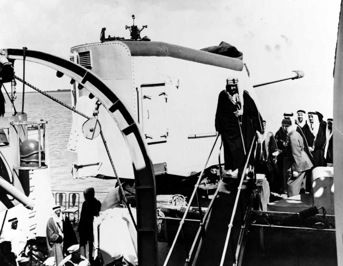 King Ibn Saud boards Quincy from Murphy in Great Bitter Lake, 14 February 1945. (Naval History and Heritage Command Photograph NH 84746)