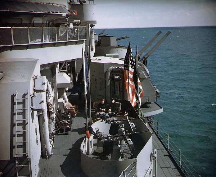 Roosevelt (right) meets King Farouk I while Quincy anchors in Great Bitter Lake, 13 February 1945. The view looks aft along the cruiser's port side from atop Turret II, and also takes in some of her 5-inch and 20 millimeter guns. (U.S. Army Signal Corps Photograph C-548, National Archives and Records Administration, Still Pictures Division, College Park, Md.)