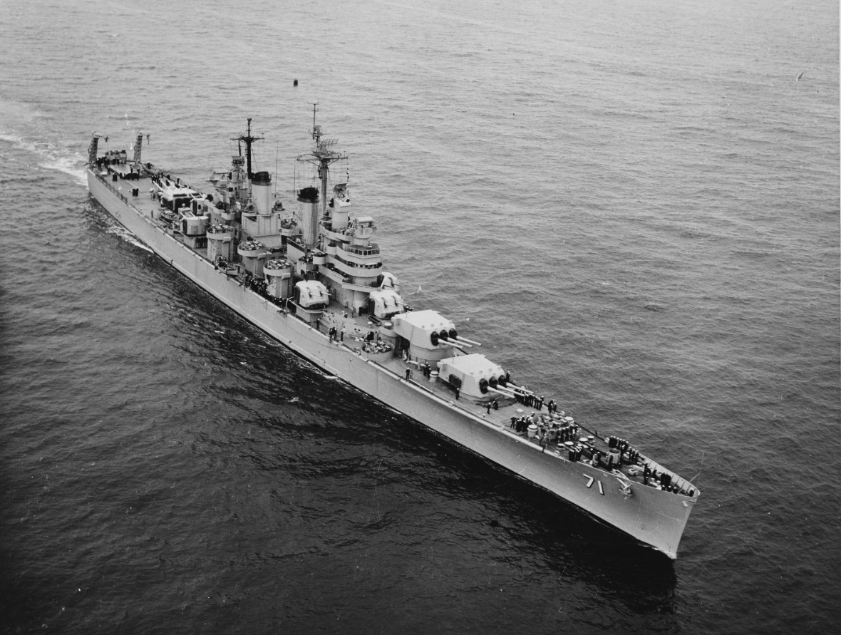 Quincy steams in the Pacific following her recommissioning to deploy to the Korean War, 1953. (Naval History and Heritage Command Photograph NH 97424)