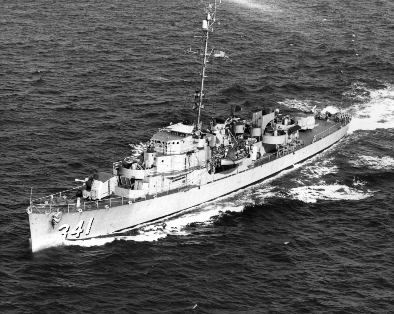 Painted in peacetime colors, Raymond is seen here underway at sea, most likely in the 1950s, her identification number in large black-shaded white numerals at her bow. All 20-millimeter guns have been removed by this point, but the twin 40-millimeters remain. Note awning over her open bridge. (Naval History and Heritage Command Photograph, L45-240.01.02)