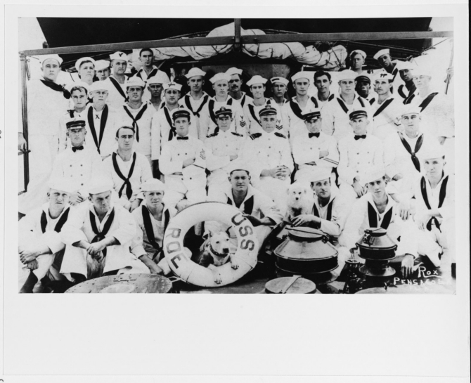 "Roe's officers and crew, circa 1915-1916. The two officers in the center are possibly (from left to right): Lt. (j.g.) Aaron S. Merrill, and Lt. (j.g.) Guy C. Barnes, Roe's commanding officer. The original photograph by Rox, 518 So. Palafox, Pensacola, Fla. was printed on a postal card, which was mailed at Pensacola on 23 September 1916 with the message: ""Look natural?"" (Naval History and Heritage Command Photograph NH 93718; courtesy of Jack Howland, 1982)."