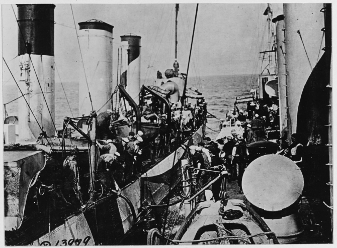 "Roe, at right, oiling from Warrington (Destroyer No. 30), at sea off  Brest, France on 1 June 1918. Note Warrington's ""dazzle"" camouflage. (Naval History and Heritage Command Photograph NH 41760)"