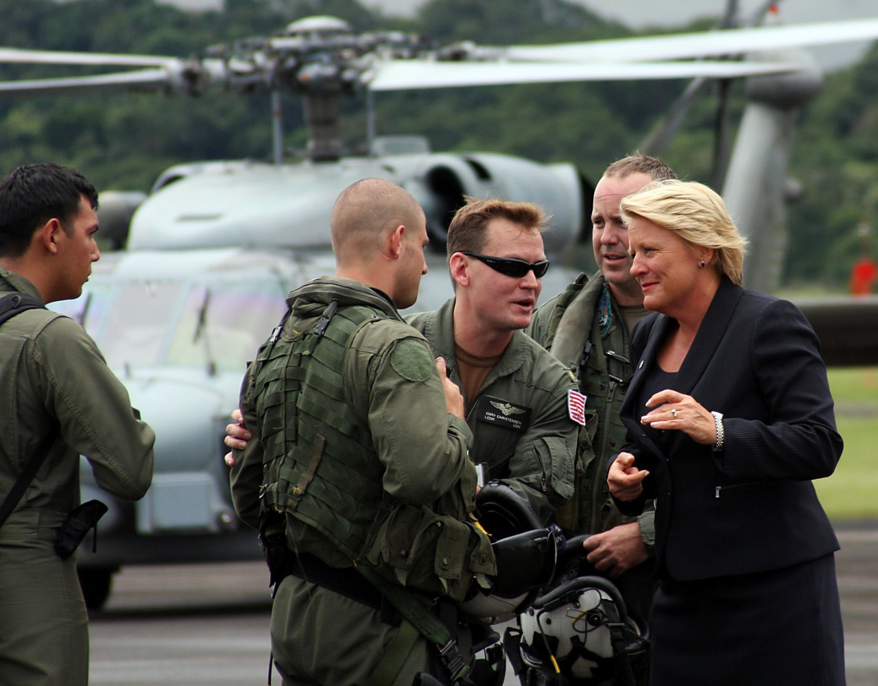 United States Ambassador to Panama Barbara Stephenson (right) and Lt. Cmdr. Cory Christensen (left), from the Office of Defense Cooperation at the U.S. Embassy at Panama, greet the aircrew of Samuel B. Roberts' embarked SH-60B Seahawk of HSL-60 Detachment 2, 26 November 2008. Torrential rains cause severe flooding in the Central American country and the ship diverts from her counter-narcotics patrols to render humanitarian assistance to the Panamanians. (U.S. Navy Photograph 081125-N-0000X-001, Navy NewsStand)