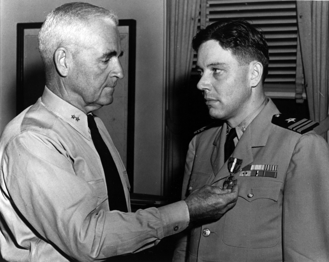 Rear Adm. David M. LeBreton awards Lt. Cmdr. Copeland the Navy Cross for heroism while in command of Samuel B. Roberts in the Battle off Samar, on 25 October 1944. This ceremony took place at Norfolk, Va., on 16 July 1945. (Naval History and Heritage Command Photograph NH 90677)
