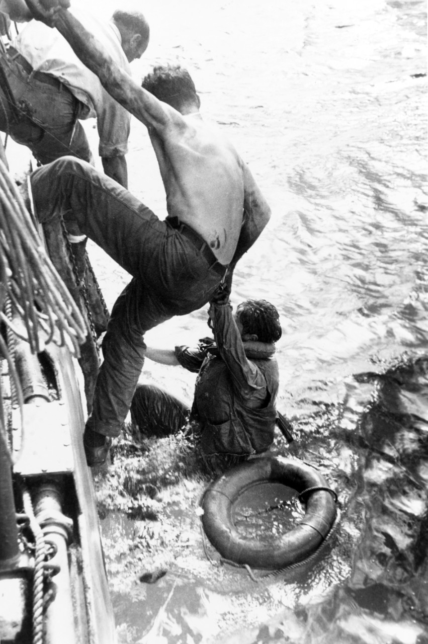 An unidentified ship rescues survivors of the Battle off Samar on 26 October 1944. Some 1,200 men of Gambier Bay (CVE-73), Hoel (DD-533), Johnston (DD-557) and Samuel B. Roberts (DE-413) survived following the action of 25 October. (U.S. Army Signal Corps Photograph 111-SC-278010, National Archives and Records Administration, Still Pictures Division, College Park, Md.)