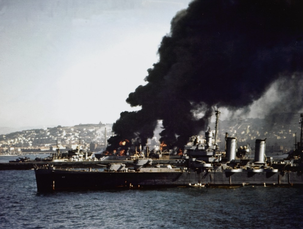 Savannah stands by to render assistance as vessels burn after Norwegian cargo ship Bjørkhaug explodes in Algiers harbor, 16 July 1943. (U.S. Navy Photograph 80-G-K-3965, National Archives and Records Administration, Still Pictures Division, College Park, Md.)
