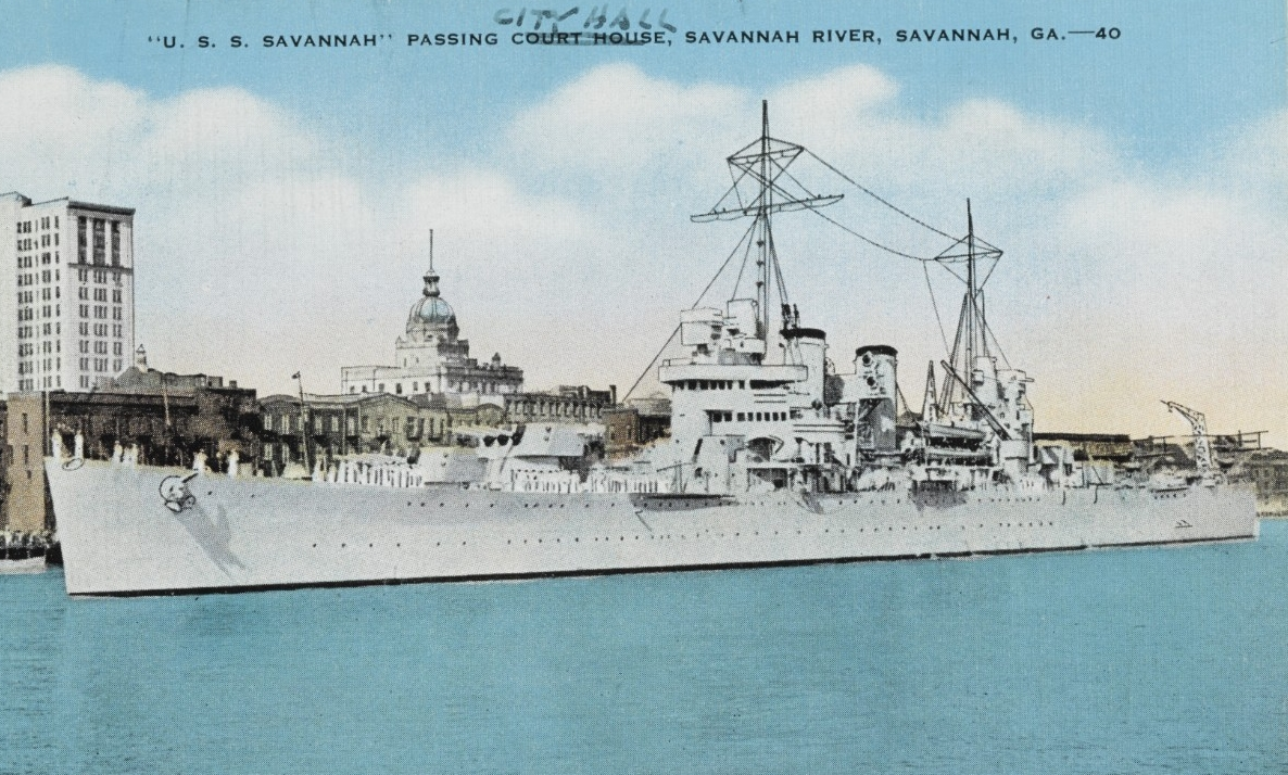 A postcard picture shows the ship as she passes City Hall to starboard while visiting Savannah, Ga., on her shakedown cruise, 1938. (U.S. Navy Photograph NH 108695, Naval History and Heritage Command)