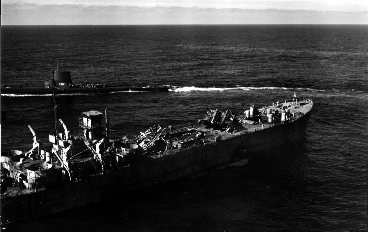 Segundo, her men on deck to view the destruction (note portions of the upper deck torn and blown upwards), passes close aboard ex-LST-482, 29 February 1956. (U.S. Navy Photograph 80-G-688137, National Archives and Records Administration, Still Pictures Division, College Park, Md.)