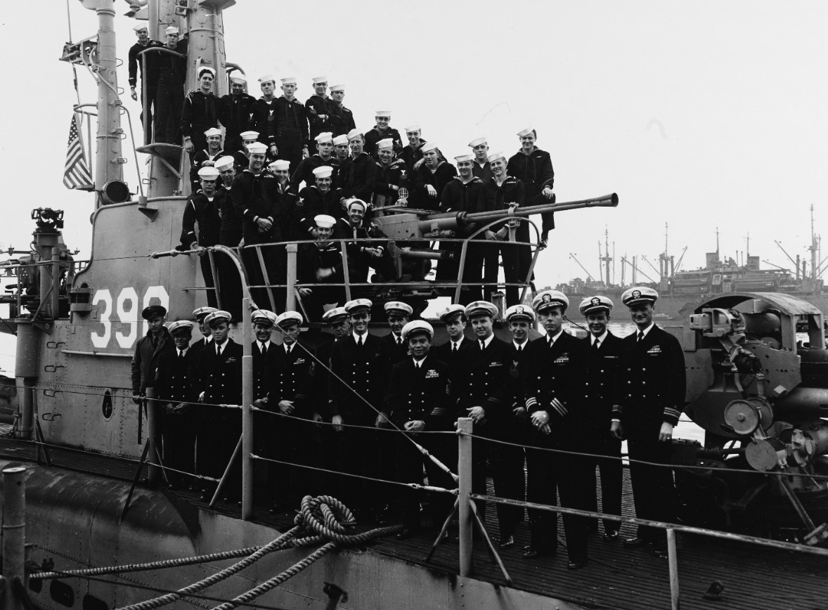 Group portrait of the crew of Segundo, photographed by O.W. Waterman, at her homeport of San Diego, about 1946. (Naval History and Heritage Command Photograph NH 64044)