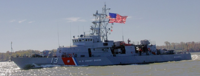 "Coast Guard Cutter Shamal (WPC-13) patrols the Potomac River near the Naval Surface Warfare Center in Dahlgren, Va., 6 November 2004. The Navy transfers the ship to the Coast Guard at Little Creek, Va. and she is placed in ""Commission Special"" status. Following a two-month dockside availability at Integrated Support Command Portsmouth, Shamal steams to her new homeport of Pascagoula. (Joseph P. Cirone, USCG Photograph USCGAUX/DVIDS Photograph 1106040, Shamal (WPC-13), USCG)."
