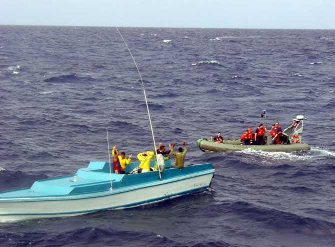 A boarding team from Shamal prepares to board a smuggling go-fast they stop about 150 miles south of the Dominican Republic, while working in tandem with the Dominican Navy and a Coast Guard jet from USCG Air Station Cape Cod, Mass., 20 January 2005. (Unattributed DoD/ DVIDS Photograph 1076623).