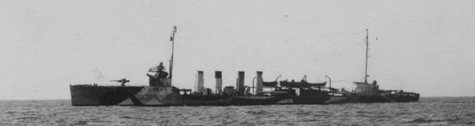 Shaw at sea, 18 May 1918, as photographed by Pvt. C. D. Donnelly, Signal Corps, from Whipple (Coast Torpedo Vessel No. 15). Although cropped from a larger image, this view of the ship shows that a shield has been added to the forward 4-inch mount, that the 1-pounder has been removed from its position forward of the bridge, and that depth charge tracks have been installed on the fantail.  Also note position of her identification number (68) on then hull directly beneath the bridge. (U.S. Army Signal Corps Photograph 111-SC-13475, National Archives and Records Administration, Still Pictures Branch, College Park, Md.)