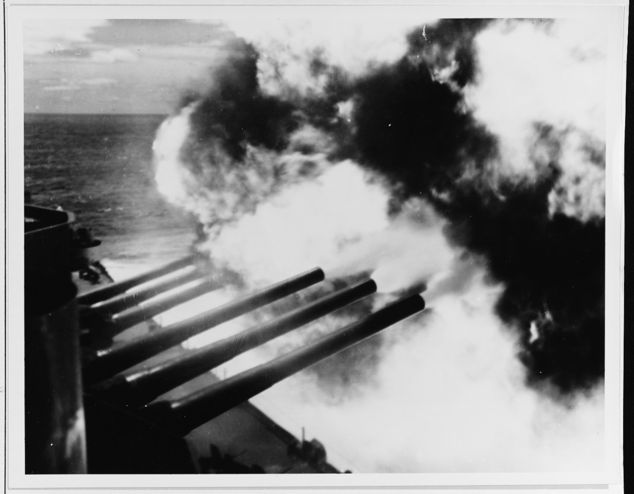 South Dakota fires her forward 16-inch guns of Turrets I and II at the Kamaishi Steel Works on Honshū, Japan, 14 July 1945. (National Archives Photograph 80-G-490175, Still Pictures Branch, National Archives & Records Administration, College Park, Md.)