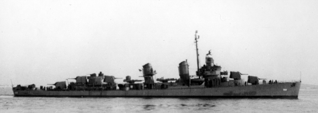 Starboard broadside view of Spence at Boston, 25 January 1943, as originally fitted-out, with a single 40-millimeter gun on her fantail, and carrying only five 20-millimeter Oerlikons. (U.S. Navy Bureau of Ships Photograph BS-40061, 19-LCM Collection, National Archives and Records Administration, Still Pictures Division, College Park, Md.)