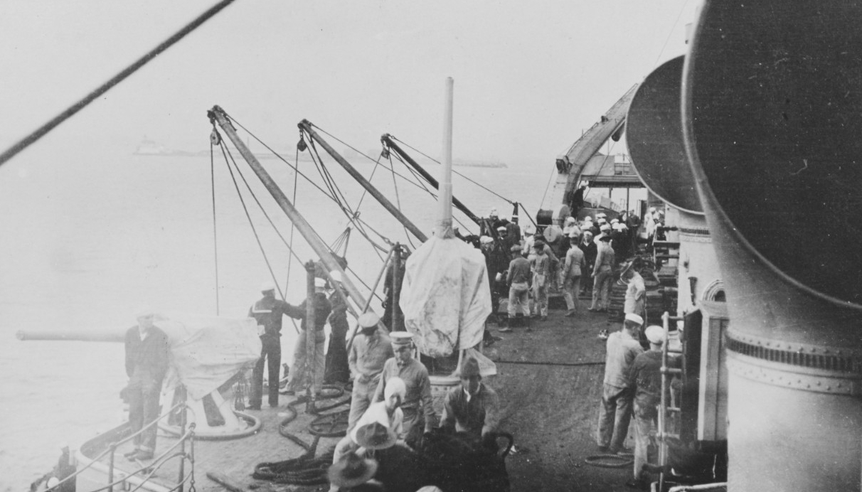 Sailors rig the ship for coaling, October 1918. (U.S. Navy Photograph NH 108528, Naval History and Heritage Command)