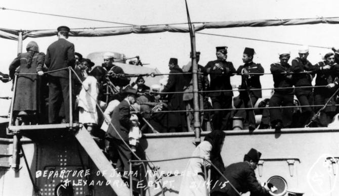 Refugees from Jaffa, Palestine, disembark at Alexandria, Egypt, 14 February 1915. (U.S. Navy Photograph NH 91707, Courtesy of Cmdr. Donald J. Robinson, MSC, Photographic Section, Naval History and Heritage Command)