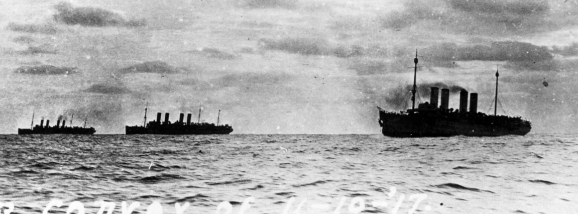 Transports steaming in convoy from New York City to Brest, France, on 10 November 1917. The ships are (from left to right): Mount Vernon (Id. No. 4508), Agamemnon (Id. No. 3004) and Von Steuben. Note the damage to Von Steuben's bow, the result of a collision with Agamemnon the previous day. (Naval History and Heritage Command Photograph NH 93859)