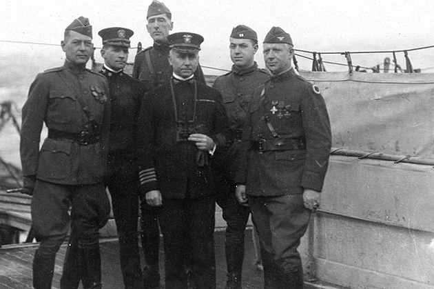 Von Steuben's commanding officer, Capt. Cyrus R. Miller, (center) with Cmdr. John W. Wilcox, Jr., his executive officer, and four Army officers, while at sea en route across the Atlantic Ocean to the United States, circa March 1919. Capt. Miller states that the colonel at right was commanding a homeward bound Ohio Regiment of Infantry, and later became National Commander of the American Legion, but did not, however, provide the colonel's name. (Naval History and Heritage Command Photograph NH 97670)