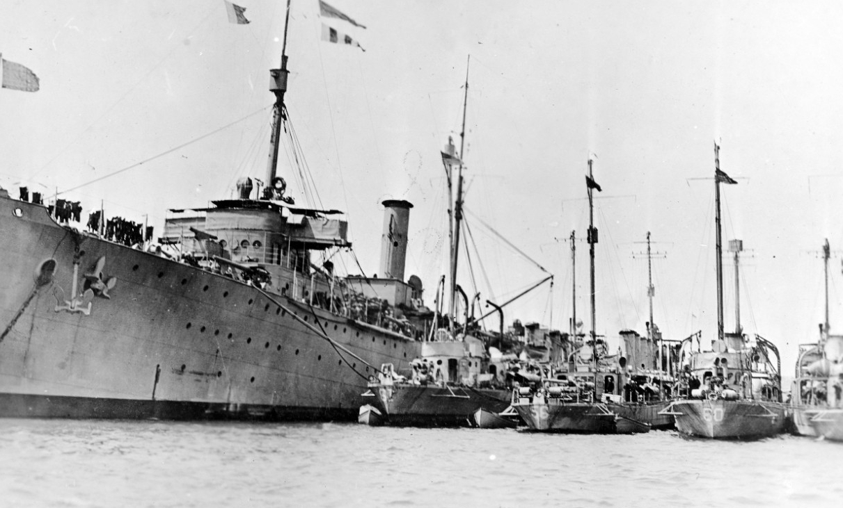 Melville tending destroyers at Queenstown, 1917. The destroyers present include (from left to right): Jacob Jones (Destroyer No. 61); Ericsson (Destroyer No. 56); Wadsworth; and an unidentified ship. (Naval History and Heritage Command Photograph  NH 46396)