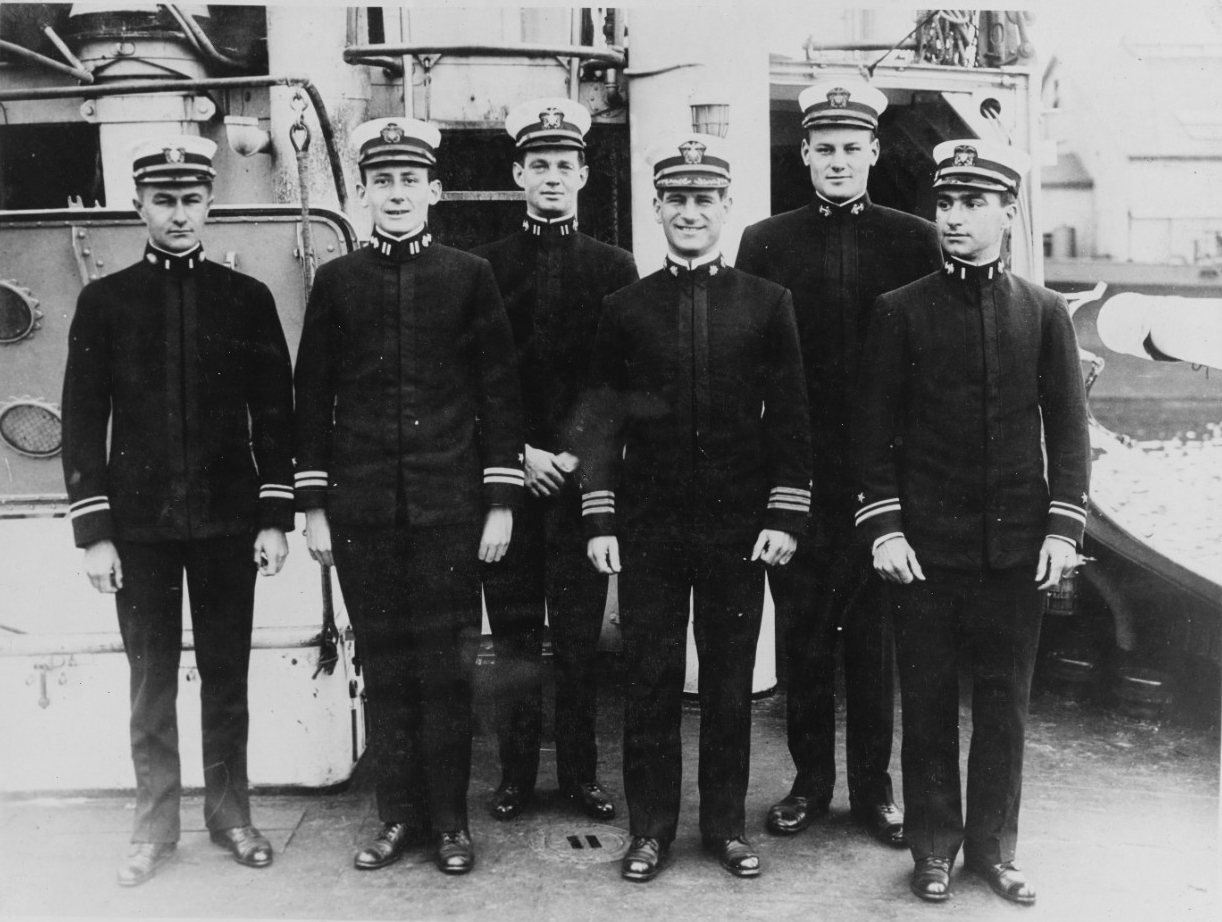 Wadsworth's wardroom officers: Assistant Surgeon Chester O. Tanner; Lt. John H. Falge; Cmdr. Joseph K. Taussig; and Lt. (j.g.) Ernest W. Broadbent. (Naval History and Heritage Command Photograph  NH 120225)