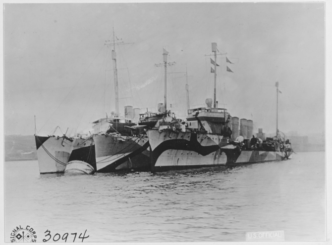 Wainwright, Winslow (Destroyer No. 53), and Bell (Destroyer No. 95) listed from right to left Moored to a buoy in the inner harbor of Brest, France on 27 October 1918. Note the various pattern camouflage designs worn by these three ships. (U.S. Army Signal Corps Photograph, Naval History and Heritage Command, NH 41513).