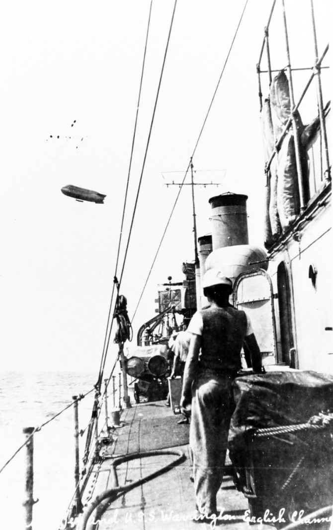 Deck view, taken while on patrol in the English Channel, 22 July 1917, with a French blimp overhead. Courtesy of Mr. Gustavus C. Robbins, Somerville, Mass., 1973. (Naval History and Heritage Command Photograph NH 77166).