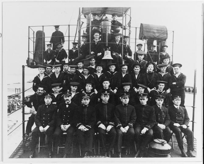 "Warrington's commissioning crew, circa March 1911. Officers are (left to right): Ens. Rufus W. Mathewson; Lt. Walter M. Hunt; Ens. Carleton M. Dolan; Ens. John B. Staley. Donor, J. Jacoby, is directly behind Lt. Hunt. Note ""USS Lewis Warrington 1910"" on the bell. Original print given to Naval Historical Foundation by Mr. J. Jacoby. (Naval History and Heritage Command Photograph NH 46944)"