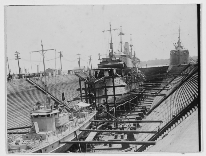 Drydocked at the Philadelphia Navy Yard, 1919. A submarine chaser is also present in the foreground. (Naval History and Heritage Command Photograph NH 46282)