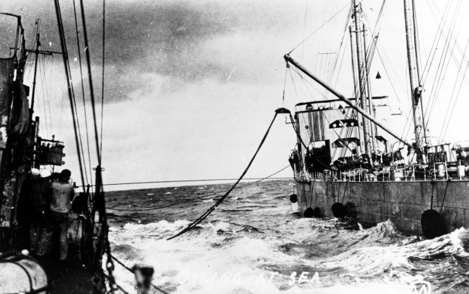 Warrington (left) oiling at sea during World War I, from either Kanawha (Fuel Ship No. 13) or Maumee (Fuel Ship No. 14). Courtesy of Mr. Gustavus C. Robbins, Somerville, Mass., 1973. (Naval History and Heritage Command Photograph NH 77154)