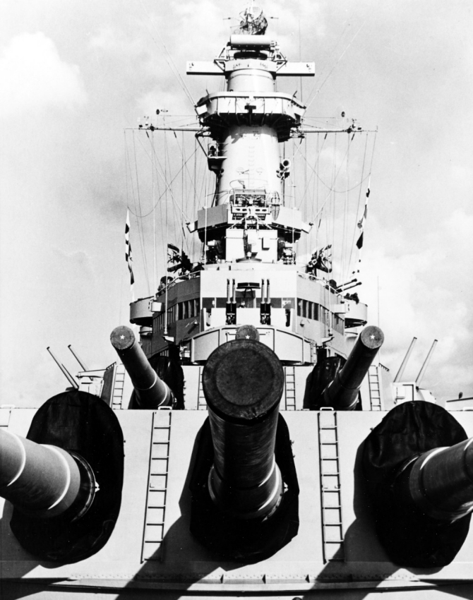 View of Wisconsin's forward 16-inch/50 guns and superstructure, taken 21 March 1952, while she was serving with Task Force 77 in Korean waters. Note her Mk.38 main battery director and various radar antennas; photographed by AF3c M.R. Adkinson. (U.S. Navy Photograph 80-G-441034, National Archives and records Administration, Still Pictures Branch, College Park, Md.).