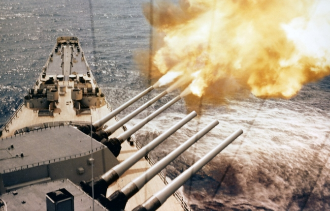 Wisconsin fires a three-gun salvo from her forward 16-inch/50 gun turret, during bombardment duty off Korea. (U.S. Navy Photograph 80-G-K-12103, National Archives and records Administration, Still Pictures Branch, College Park, Md.).